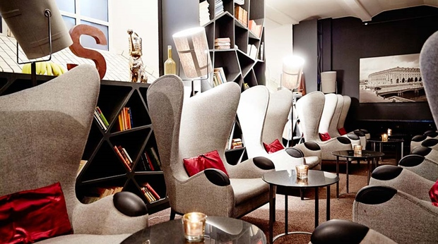 Impressive bar lounge furnished with comfortable designer chairs at Post Hotel in Gothenburg