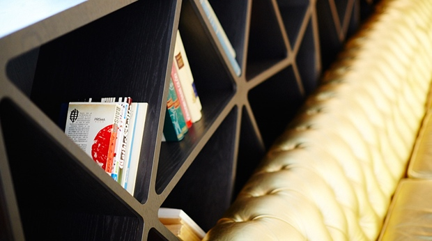 Relax and read one of the many books in the library at the bar at Post Hotel in Gothenburg