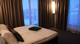 Elegant suite bedroom with an amazing view at Sense Hotel in Lulea