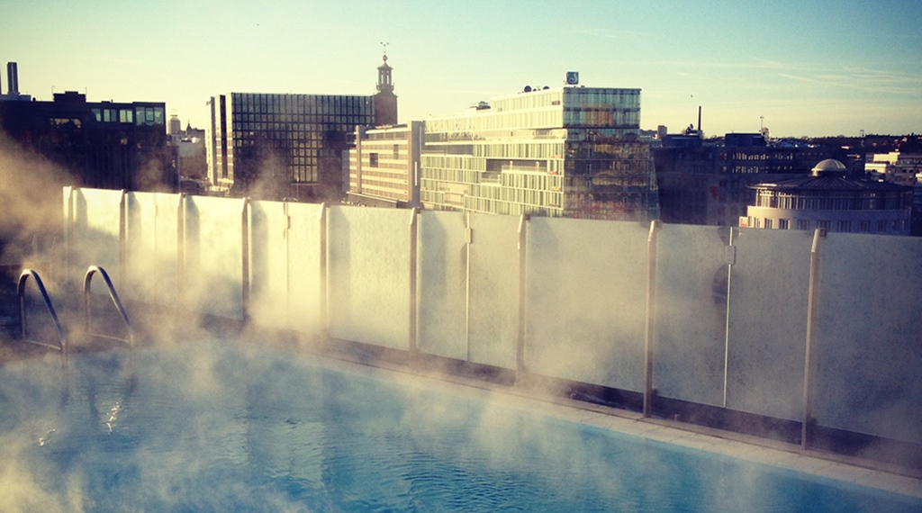 Enjoy the rooftop pool and the amazing with of the city at Sign Hotel in Stockholm