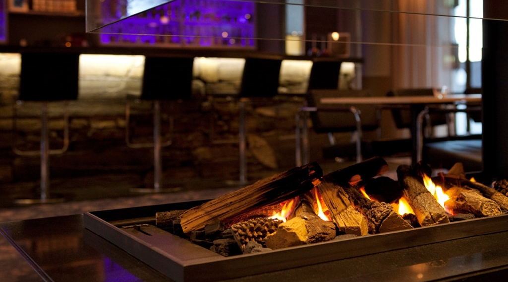 Tranquil bar area with an open fireplace at Stavanger Hotel