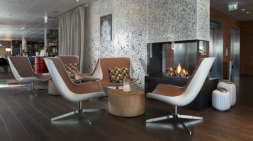 Luxurious and peaceful lounge with a fireplace at Stavanger Hotel