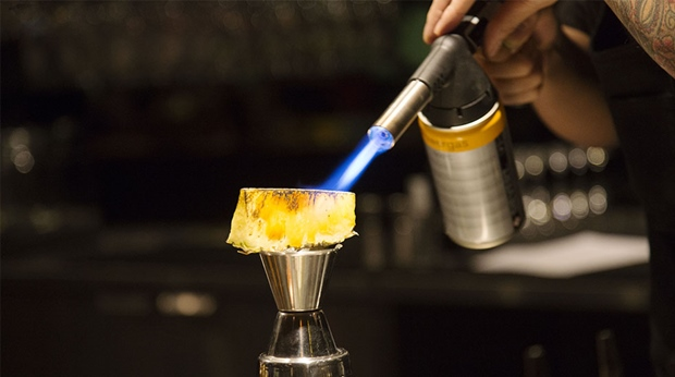 Close-up image of a pineapple being flambéed at the Vatos bar at the Clarion Hotel Stockholm