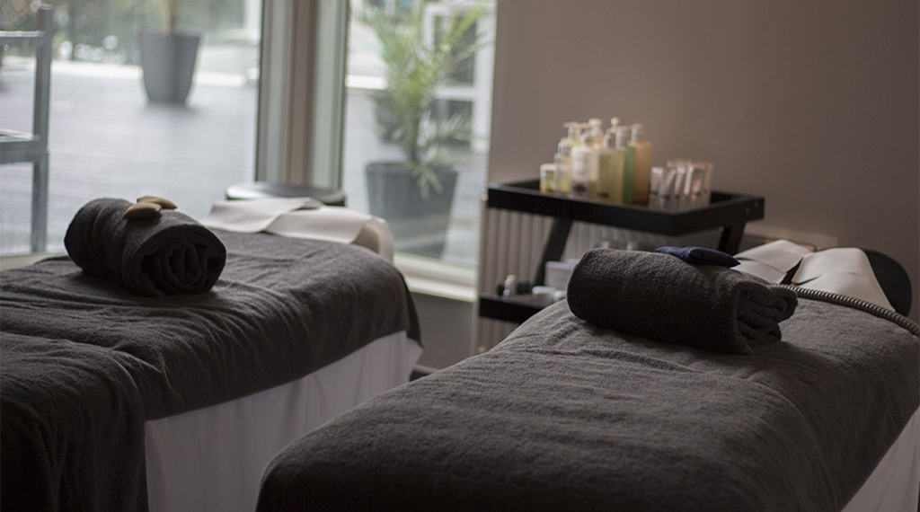 Treatment benches with towels at Elements Spa at Clarion Hotel Stockholm