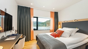 Enjoy the amazing view of the fjord from this elegant double hotel room at The Edge Hotel in Tromso