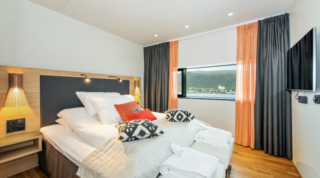 Comfortable superior double room with a beautiful view of the fjord at The Edge Hotel in Tromso