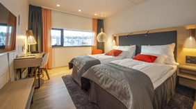 Twin hotel room with two single beds at The Edge Hotel in Tromso