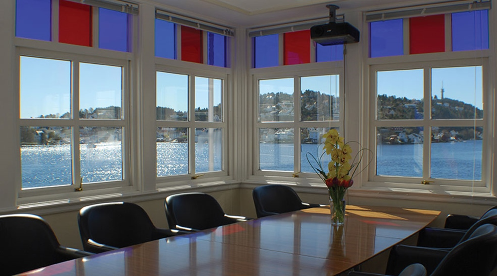 Elegant meeting room with a spectacular view of the fjord at Tyholmen Hotel in Arendal