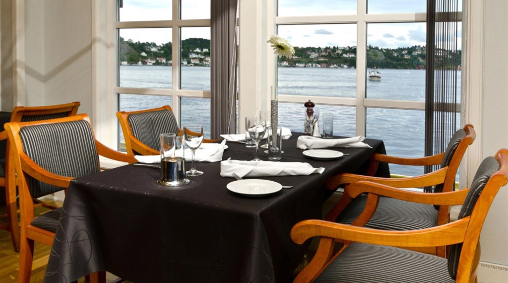 Quality restaurant with a perfect view of the fjord at Tyholmen Hotel in Arendal