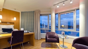 Luxurious deluxe hotel room with the perfect view of the fjord at Tyholmen Hotel in Arendal