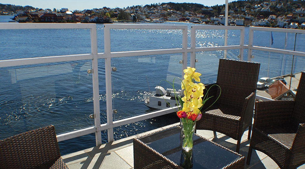 Sit directly by the waterfront on the terrace at Tyholmen Hotel in Arendal