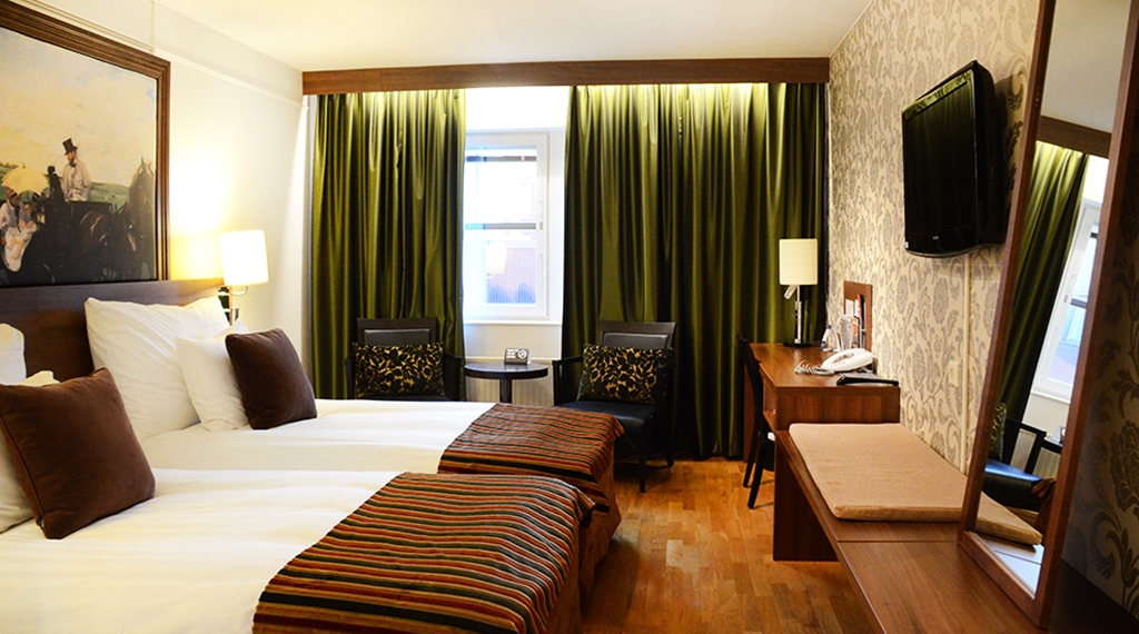 Elegant and well-designed superior hotel room at Winn Hotel in Gavle