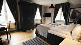 Spacious and stylish superior double hotel room at Wisby Hotel in Visby