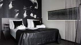 The AC/DC suite, double bed with leatherblanket at Comfort Hotel Union Brygge Drammen