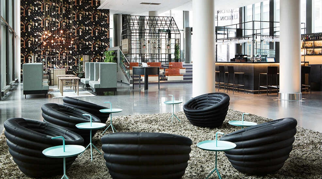 Lobby with lounge area and black chairs at Comfort Hotel Union Brygge in Drammen Norway