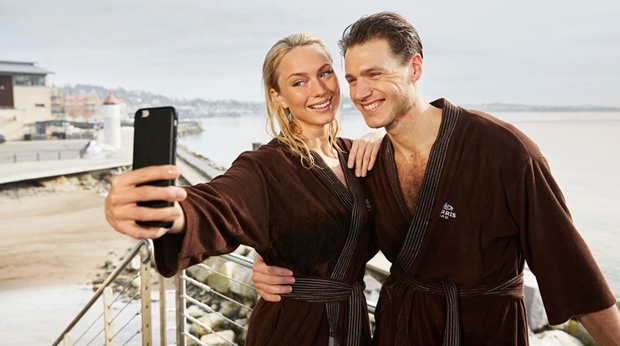Couple taking selfie in bathrobes at Farris Bad