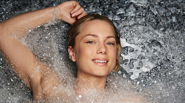 Woman surrounded by foam at Farris Bad