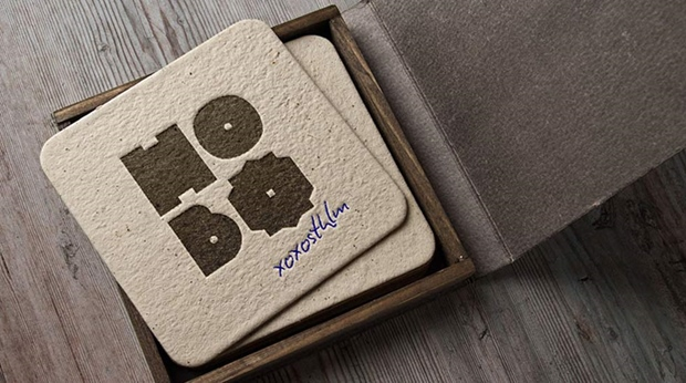 Brown cardboard coaster with logotype at hotel Hobo in Stockholm, Sweden