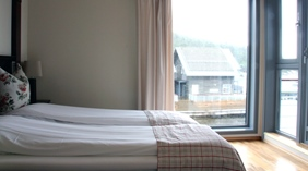 Junior suite with a great view of the harbour and fjord at Spa & Hotel Holmsbu