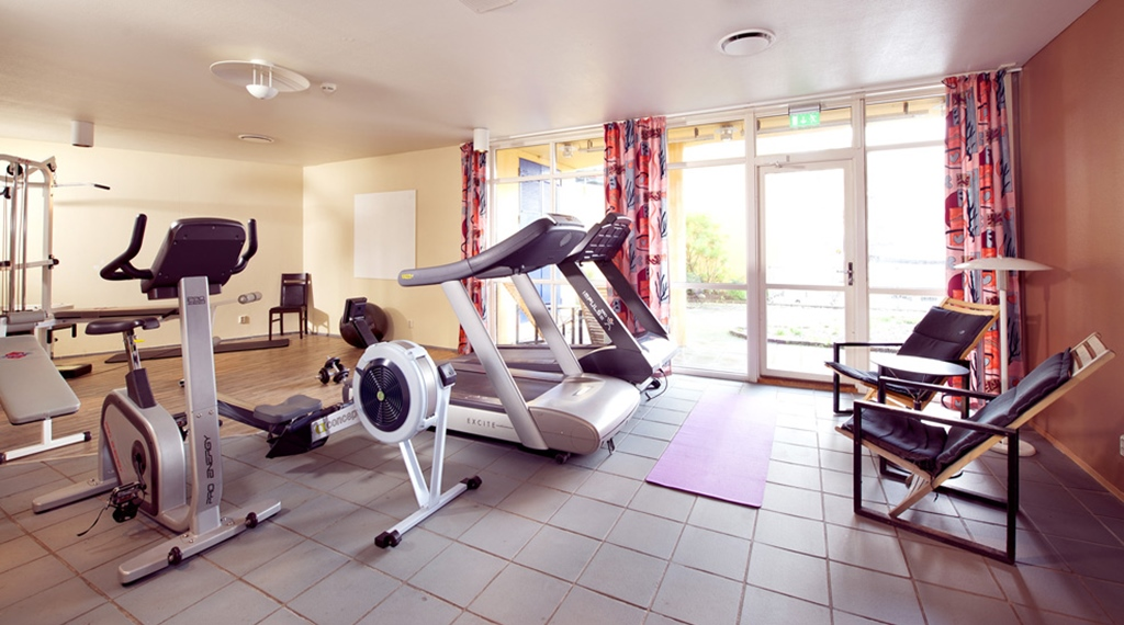 Bright and well-equipped gym at Bryggen Hotel in Alesund