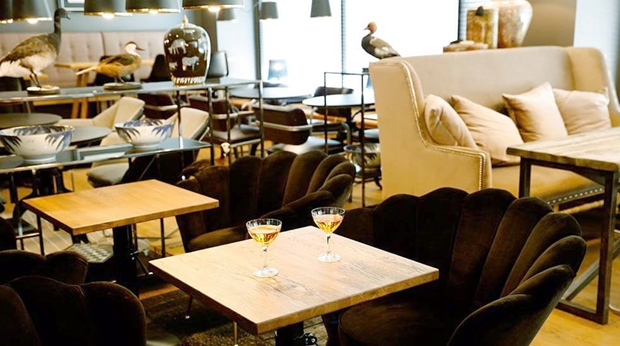 Tables and chairs at Bar Runar at Hotel F6 in Helsinki, Finland