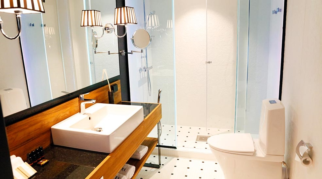 Fully tiled bathroom with shower in a hotel room at Hotel F6 in Helsinki, Finland