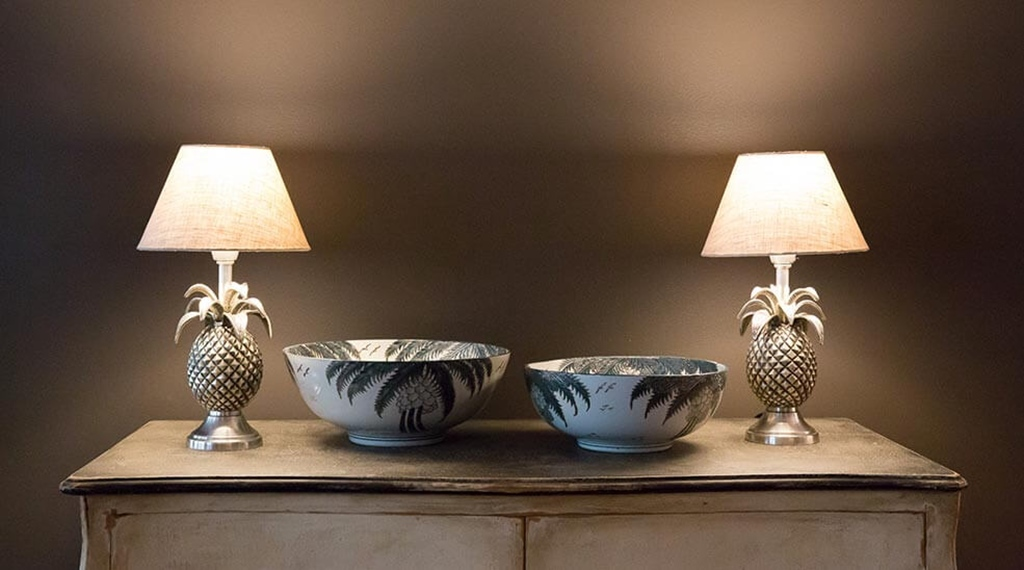 Interior detail of two bowls and two pineapple lamps at Hotel F6 in Helsinki, Finland
