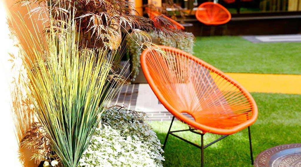 Orange garden chair at Hotel F6 in Helsinki, Finland
