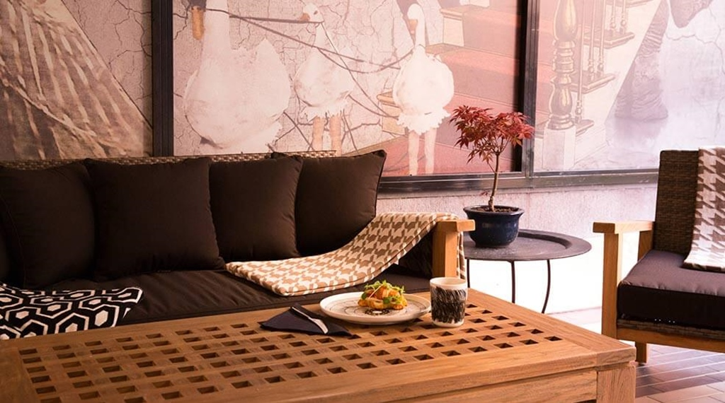Seating area and breakfast at hotel F6 in Helsinki, Finland