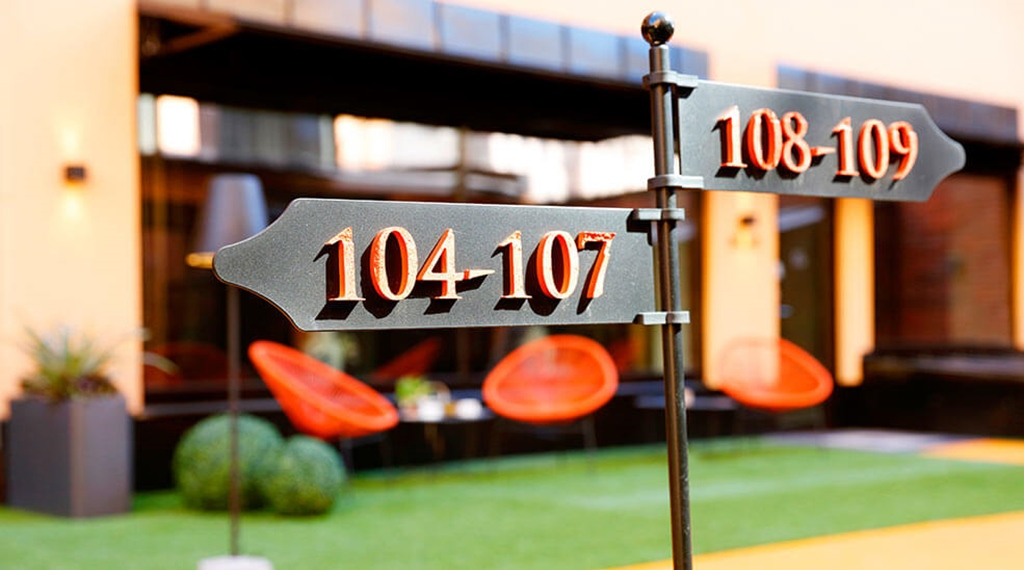 Metal signs with hotel room numbers in the garden of Hotel F6 in Helsinki, Finland