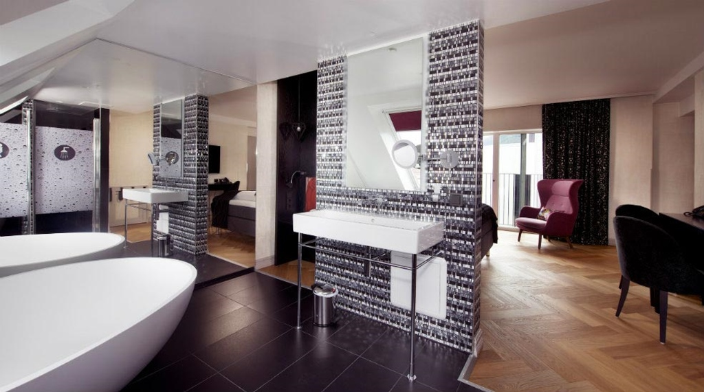 Large and hip suite with large bathroom and a French balcony at Oleana Hotel in Bergen