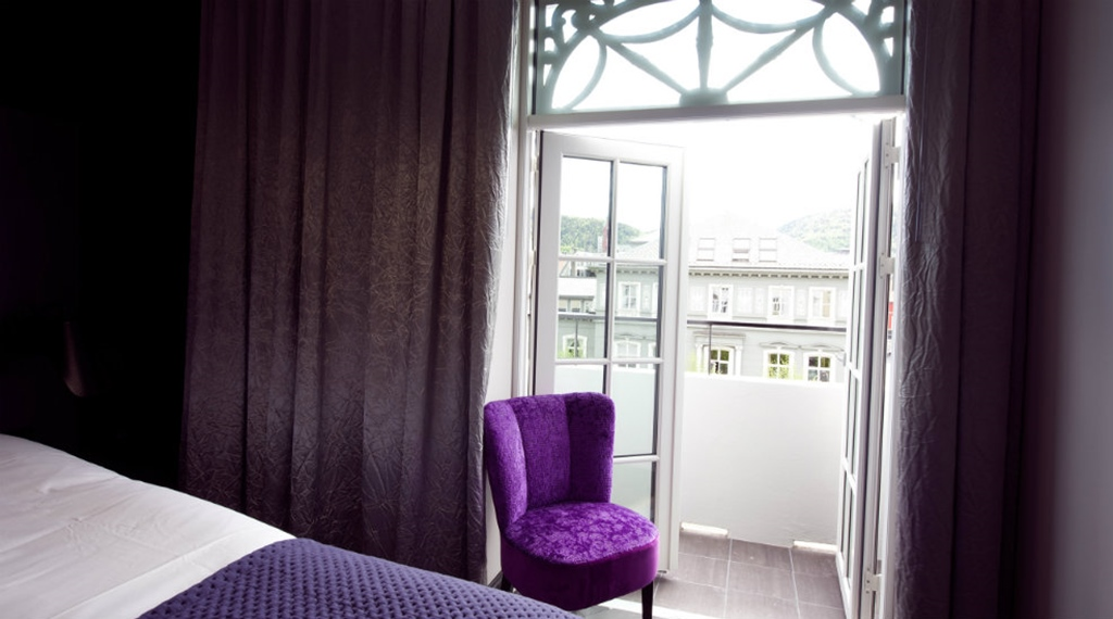 Fashionable hotel room with private terrace and a nice view at Oleana Hotel in Bergen