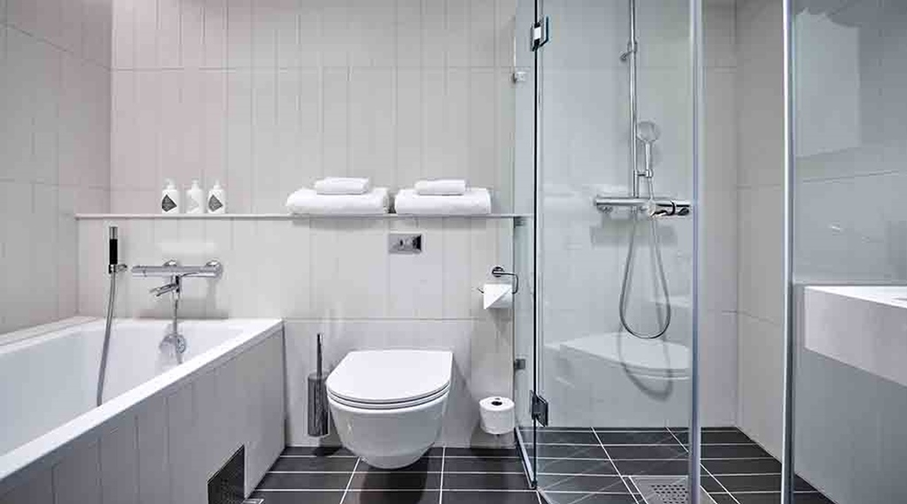 Tasteful bathroom with toilet, shower and bathtub at Nordic Light Hotel in Stockholm, Sweden