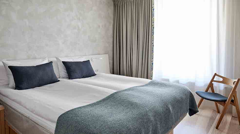 Double Bed And Chair In Standard Single Hotel Room With Window At Nordic  Light Hotel In