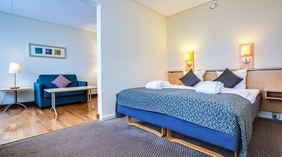 Deluxe hotel room with seperate living room area at Quality Airport Dan Hotel in Copenhagen