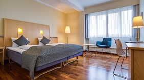 Spacious twin hotel room with two large beds at Quality Airport Dan Hotel in Copenhagen
