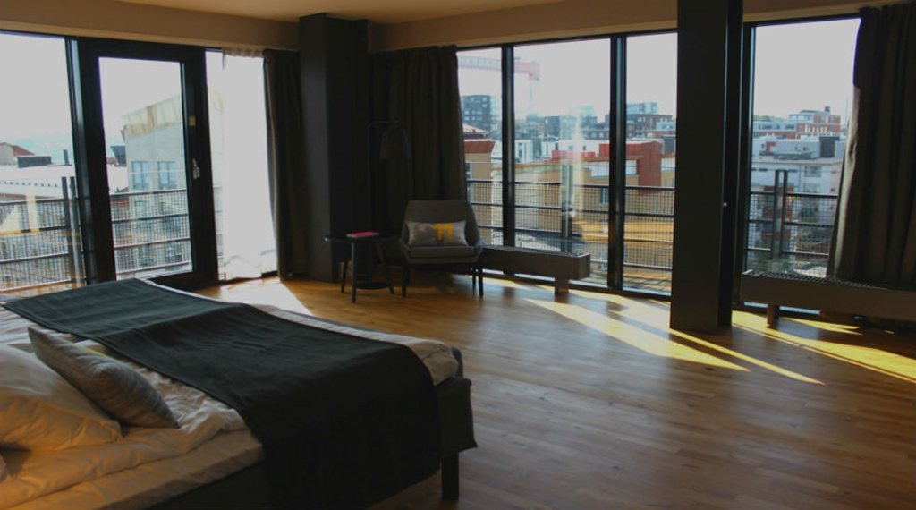 Enjoy the stunning view of the city from this elegant four corner suite at Quality Hotel 11 in Gothenburg