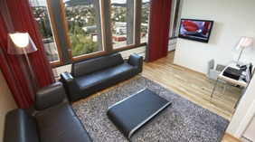 Suite with elegant designer furniture and an amazing view at Quality Hotel 33 in Oslo