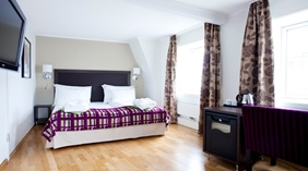 Bright and spacious standard double hotel room at Quality Augustin Hotel in Trondheim