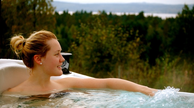 Enjoying the outdoor spa jacuzzi and the perfect view of the lake at Quality Dalecarlia Hotel in Tallberg