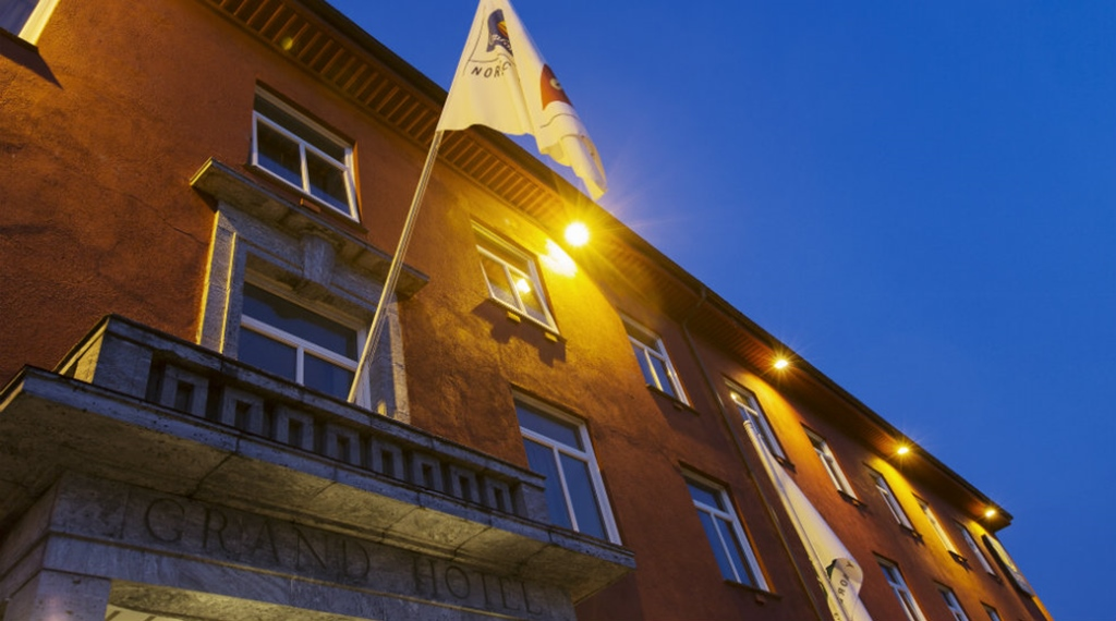 Flag with the hotel logo hanging over the entrance of the Quality Grand Hotel in Kristiansund