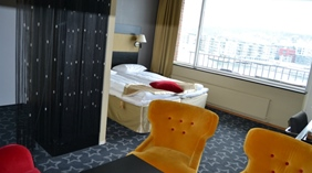 Well-furnished deluxe double hotel room with a great view of the city at Quality Klubben Hotel in Tonsberg