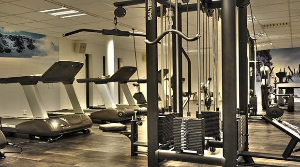 Large gym with several modern fitness machines at Quality Lapland Hotel in Gallivare