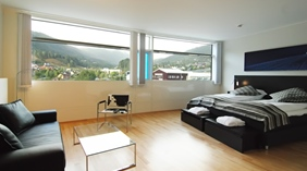 Spacious and well-furnished deluxe hotel room with a stunning view of the mountains at Quality Hotel Sogndal