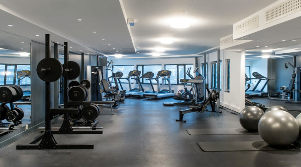 Gym with free weights, pilates balls and running machines at the Quality Hotel Tønsberg
