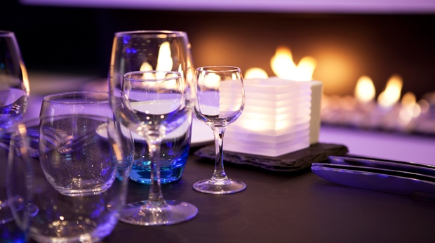 Stylish and peaceful restaurant with an open fireplace at Quality Waterfront Hotel in Alesund