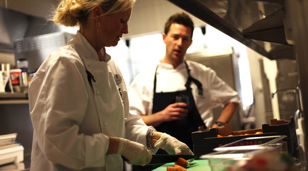 Chefs preparing gourmet food in the kitchen of the Aqua Restaurant at Quality Waterfront Hotel in Alesund