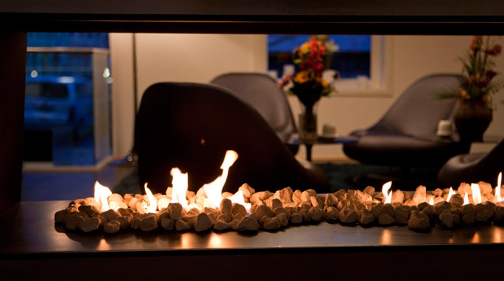 Tranquil lounge with an open fireplace at Quality Waterfront Hotel in Alesund