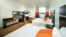 Large and well-equipped double family hotel room with two double beds at Quality Winn Hotel in Goteborg