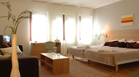 Elegant and bright family hotel room with a double bed and a sofa bed at Quality Winn Hotel in Haninge